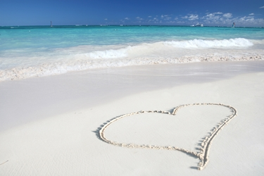 http://www.dreamstime.com/royalty-free-stock-image-love-heart-sand-beach-tropical-ocean-image7767466